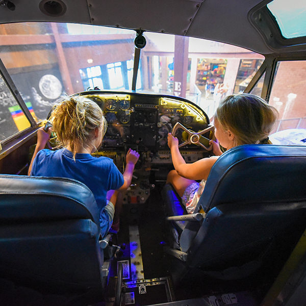 girls playing in the airplane cockpit